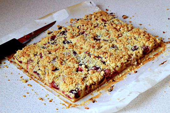 rhubarb and cherry crumb bars step by step picture recipe, using the paper overhand, lift your cake from the pan and cut into bars