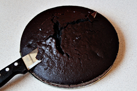 Chocolate Cake With Chocolate Buttercream Frosting, There's a chance that the middle of the cake will rise more than the rest of it, just like it happened to me. If this happens to you, don't worry. You can actually turn this situation to your advantage. Just grab a long sharp knife and slice off the part of the cake that has risen farther than the edges.