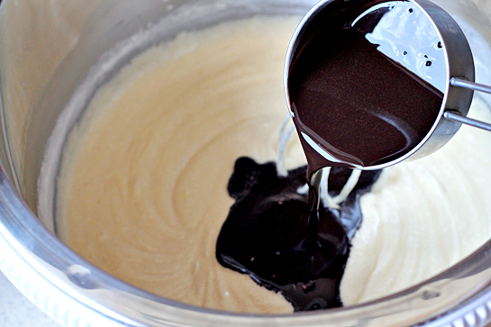 Chocolate Cake With Chocolate Buttercream Frosting, stirring in gently, add a couple of spoonfuls of flour to the cake mixture, then add a couple of spoonfuls of cocoa mixture, continue alternating - cocoa and flour - until it is all stirred in