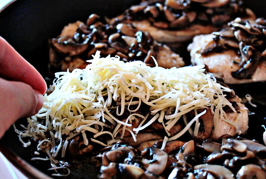 chicken with mushrooms and cheese step by step recipe with ingredients and pictures, distribute shredded cheese evenly over cooked chicken fillets covered with mushroom sauce