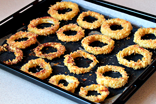oven-fried onion rings with potato chips coating, recipe with step by step pictures, baked oven fried-onion rings on a baking sheet removed from the oven