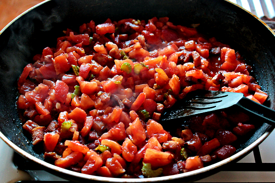 Pasta With Bacon And Tomato Sauce step by step recipe with pictures, bacon, celery and chopped tomato in a large frying pan or skilled
