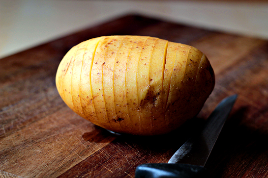 Scalloped hasselback potatoes step by step picture recipe. Using a sharp knife, make slices across the potato, being sure to stop before you reach its bottom.