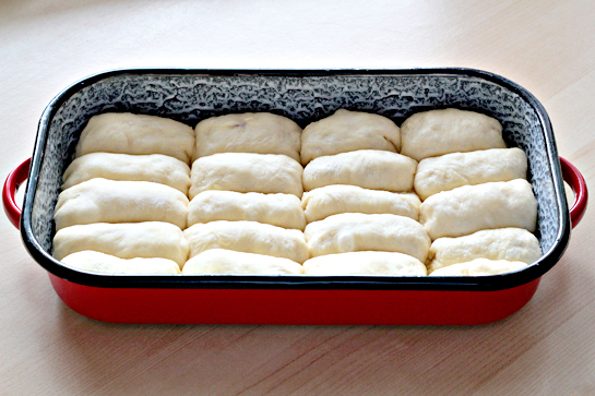 sweet jam filled buns in a baking pan