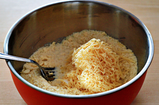 Garlic and cheese biscuits recipe with step by step pictures. Flour, garlic and salt in a bowl, Add milk. Add shredded cheese.
