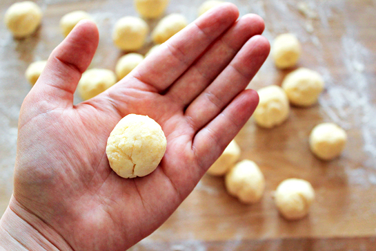 Garlic and cheese biscuit recipe with step by step pictures. Forming balls out of the even dough pieces.