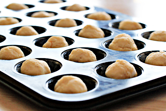 Garlic and cheese biscuits recipe with step by step pictures. Mini dough balls placed in greased and floured mini muffin cups. Bake.