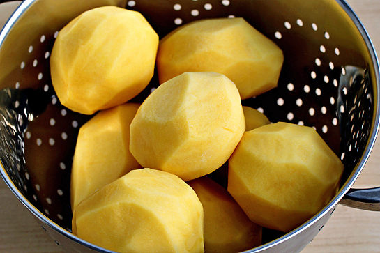 man-approved-spicy-oven-baked-french-fries-step-by-step-recipe-potatoes-in-a-bowl