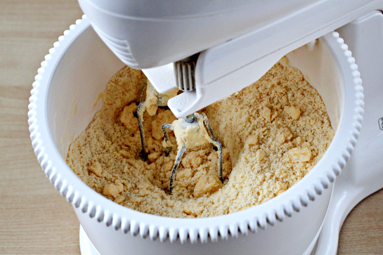 pie pops recipe with step by step pictures, preheat the oven to 350 F (175 C), place the flour, salt, and sugar (5 tablespoons) in the bowl of your electric mixer. First, stir with a spoon to combine, then  add the butter (cubed) and mix until the mixture resembles coarse meal