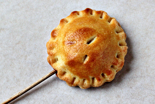 Pie pops recipe with step by step pictures. Mix the egg yolk with the milk and brush the top of each pie pop with this mixture. Using a sharp knife, cut three vents in each pie. Bake in the preheated oven at 350 F (175 C) for about 20-25 minutes or until golden-brown.