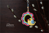 Crochet bird sitting on a wreath ornament pattern