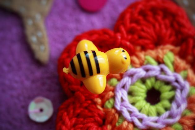 bee pin on a crochet flower