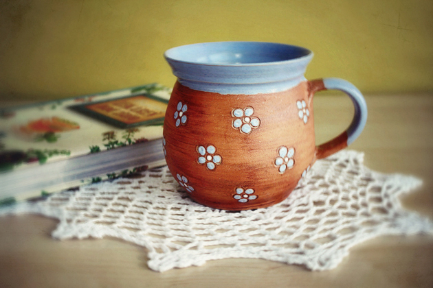 blue handmade mug with small flowers