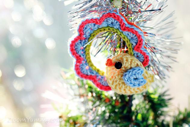 little crochet bird on a crochet wreath ornament on Christmas tree